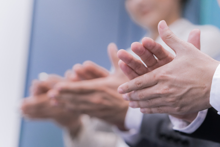 ovation: Close-up of business people clapping hands. Business seminar concept