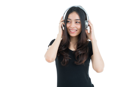 sexy girl dance: Young motion woman with headphones listening music on white background.