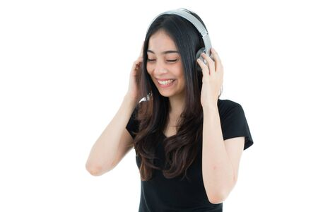 music background: Young motion woman with headphones listening music on white background.