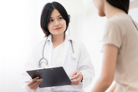 Female doctor consulting patient. Asian people Stock Photo - 84053367
