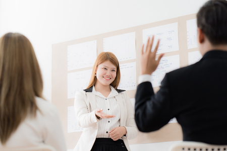 Businesswoman presenting financial to partners in office. Asian people Stock Photo