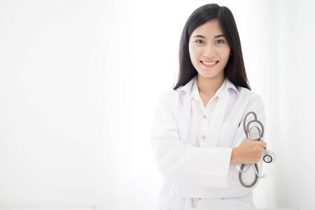 Smiling medical doctor woman with stethoscope. Asian people