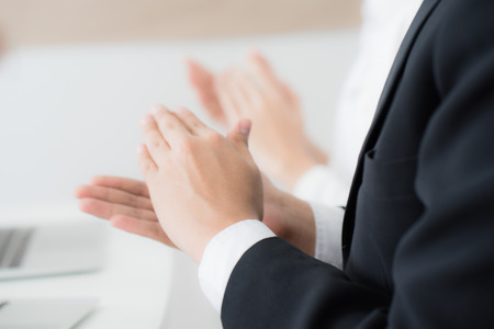 Business people applauding to a successful speaker. Asian people