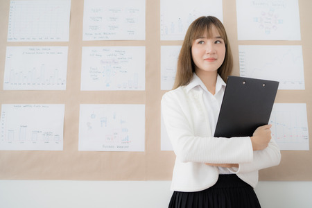 Businesswoman standing in the office. Asian people Stock Photo