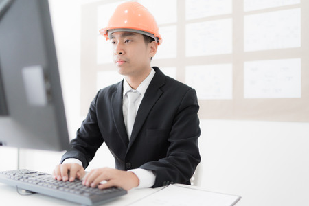Young engineer using laptop. Asian people