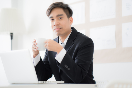 Businessman working laptop in office. Asian people Banque d'images
