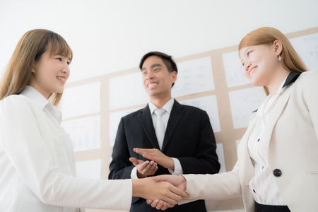 Business people shaking hands during a meeting. Asian people