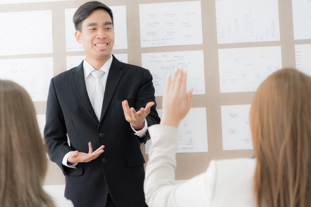 Businessman presenting financial to partners in office. Asian people Stock Photo