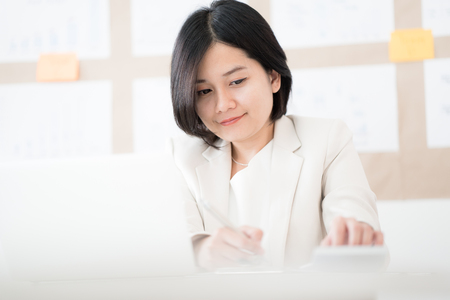 Portrait of businesswoman working in the office. Asian people Stock Photo
