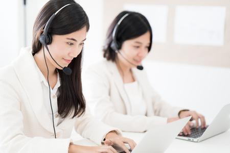 Asian young woman working in call centre
