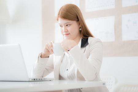 Businesswoman working laptop in office