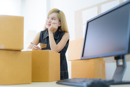 Young Asian woman working online shopping at home office