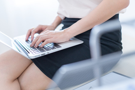 Business women reviewing data in financial charts and graphs in the office Banque d'images