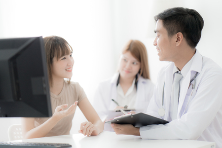 Doctors and patient talking about therapy. Asian people