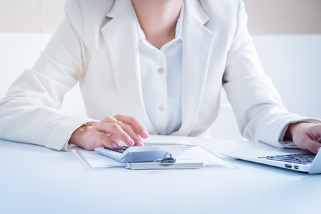 Asian business women reviewing data in financial charts and graphs Stock Photo