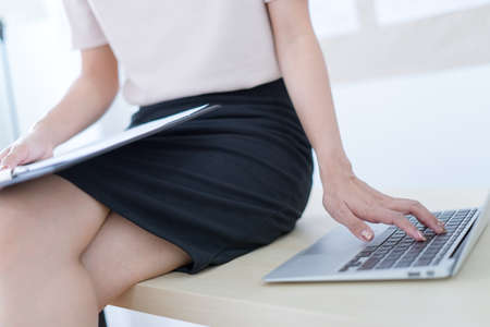 Business women reviewing data in financial charts and graphs in the office Stock Photo