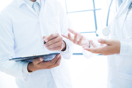 Doctors discussing images standing in front Stock Photo