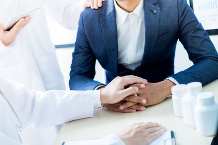 Doctor explaining for patient at consulting room