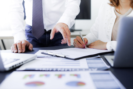 Female hand signing contract. Stock Photo