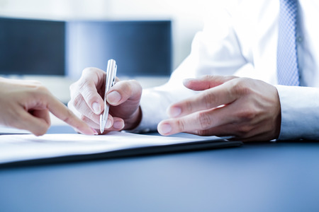 Businessman hand signing contract.