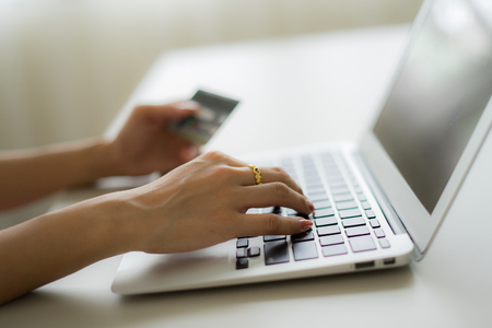 Woman Hands holding credit card and using laptop. Online shopping