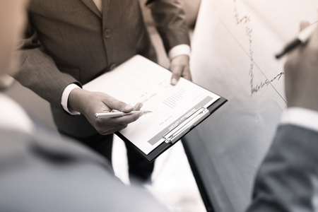 two young businessmen discussing project at meeting Stock Photo