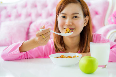 Asian woman Eating healthy breakfast bowl Stock Photo
