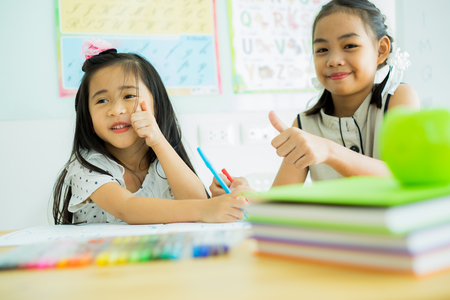 Asian cute little child girl drawing at home Stock Photo