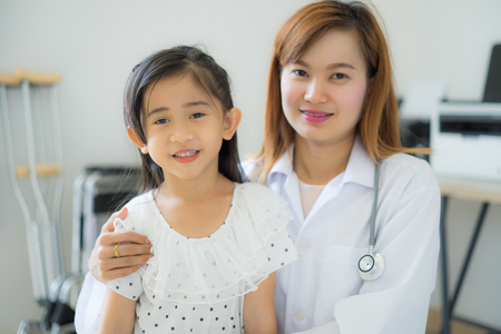 Asian cute girl visiting a doctor Stock Photo