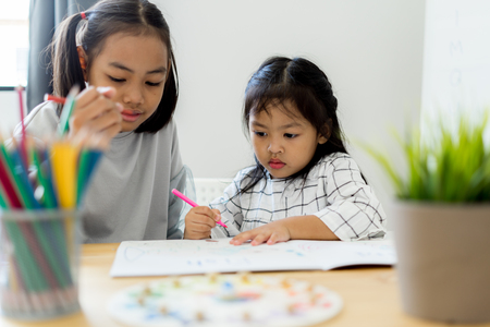 Asian cute little child girl drawing at home. Education concept Zdjęcie Seryjne