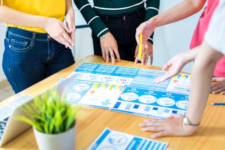 Asian female Designers Having Brainstorming Meeting In Office