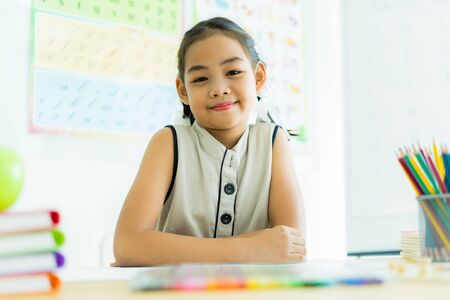 Asian cute little child girl drawing at home