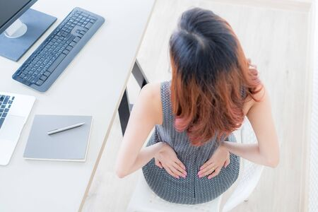 Business woman with back pain. Office syndrome