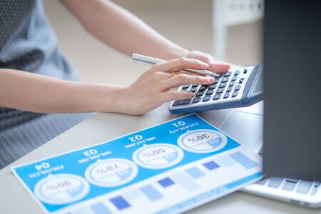 Asian business woman reviewing data in financial charts and graphs. Accounting Banco de Imagens - 129960201