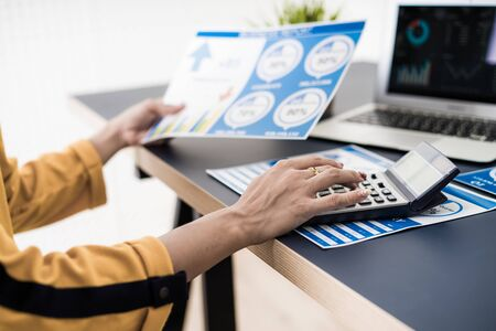Business women reviewing data in financial charts and graphs. Accounting Banco de Imagens - 129960203