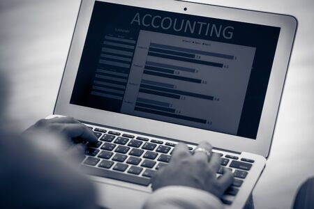 Asian business woman reviewing data in financial charts and graphs. Accounting Banco de Imagens - 129963908