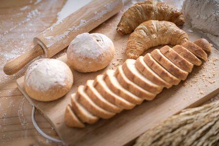 Different fresh bread on wooden table Zdjęcie Seryjne