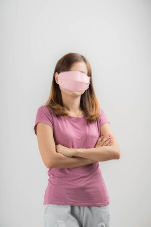 Close up portrait of young woman with medicine health care mask against white white background. CoronaVirus, Covid-19. Asian people Stock Photo
