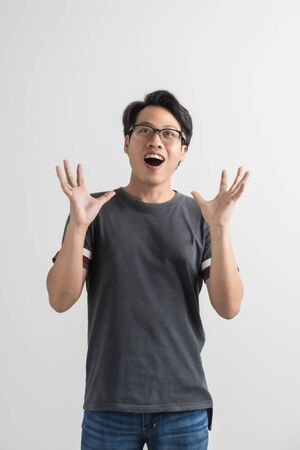 Do not miss. Young asian man shouting. Shout. Crying emotional man screaming on pink studio background. man half-length portrait. man emotions, facial expression concept. Trendy