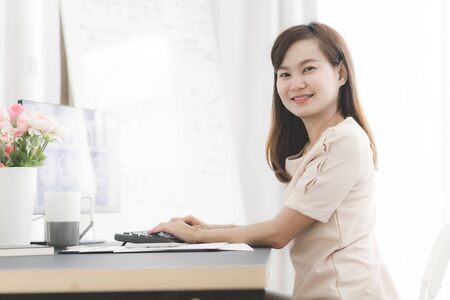 Young asia woman working at home or in a small office. Asian people