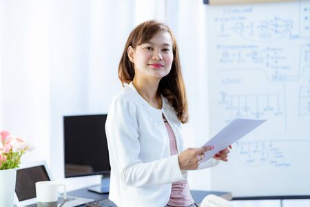Young woman working at home or in a small office. Asian People