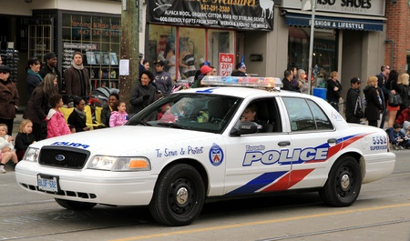 A police vehicle during a street parade in Toronto, Ontario 報道画像