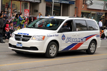 light duty: A police vehicle during a street parade in Toronto, Ontario Editorial