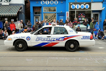A police vehicle during a street parade in Toronto, Ontario