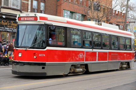 A Toronto streetcar during a street parade Stock Photo - 13353386