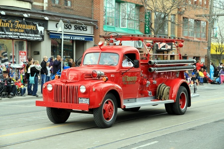 accident fire truck: A Toronto fire fighting vehicle during a street parade