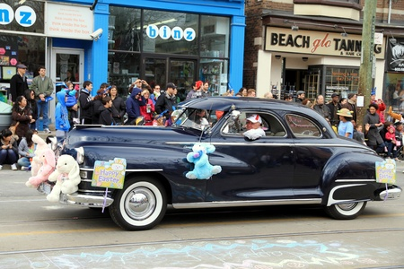 An old Cadillac during the Easter Parade 2012 in Toronto Stock Photo - 13353378