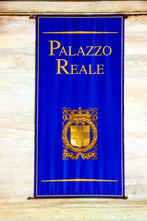 A banner of Turin Palazzo Reale with the symbol of the building