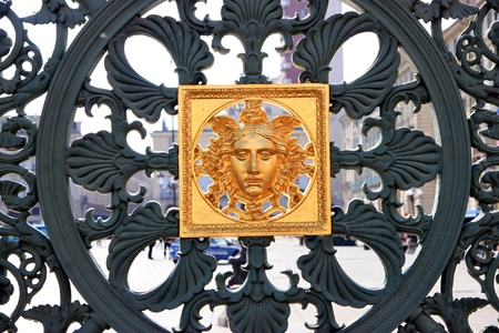Golden ornaments on the Turin Royal Palace access gate photo