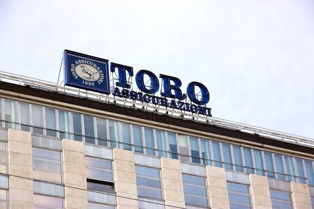 A Toro Assicurazioni sign on the top of a building in Turin, Italy